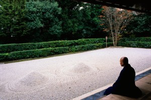 Monk Meditating at a Rock Garden
